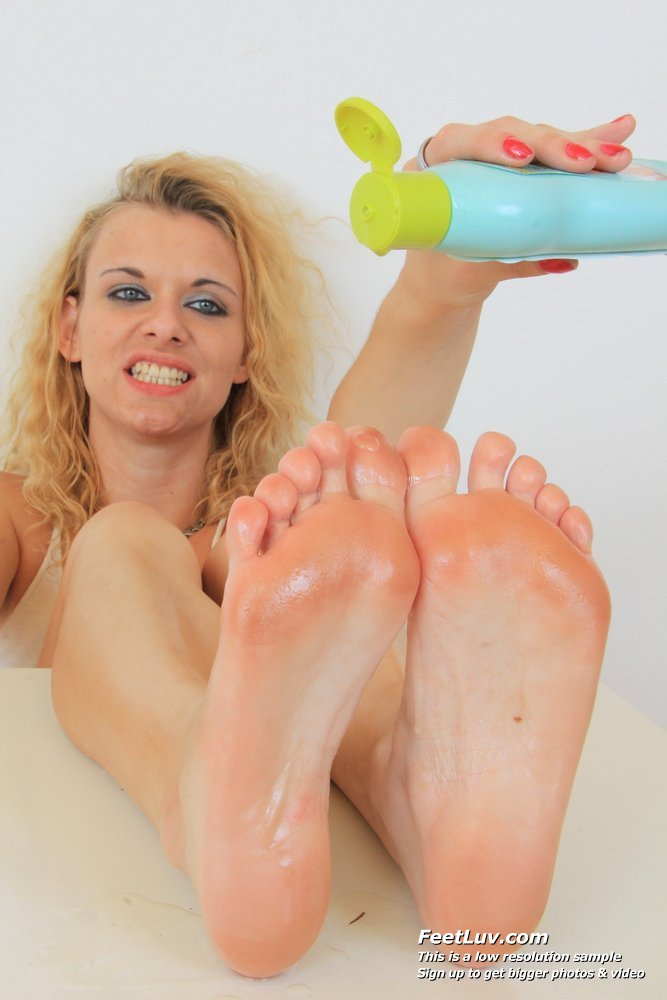 Hot blondie gives footjobs to sex toy 7
